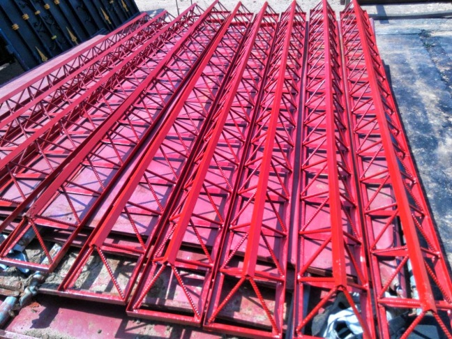 finished octet trusses sprayed and loaded in truck bed